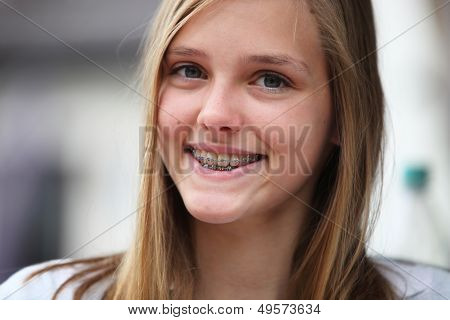 Young Teenage Girl With Orthodontic Braces