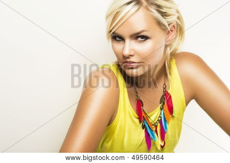 Beautiful Blond Woman With A Sultry Look