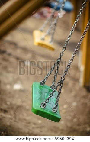 Chain Swings Falling Down In The Playground, Autumn, Fall Playground, Green Swings,visible Yellow S