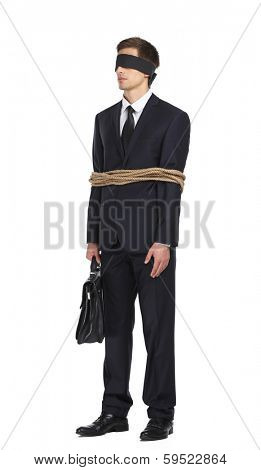 Full-length portrait of blind-folded businessman tied with the rope, isolated on white. Concept of slavery and violence