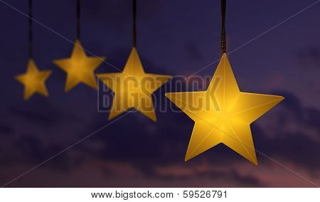 Hanging Star Shaped String Lights Over A Dark Sunset Sky