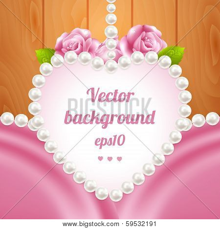 Pink rose and pearls frame on wood background