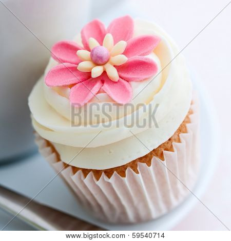 Cupcake decorated with a pink sugar flower