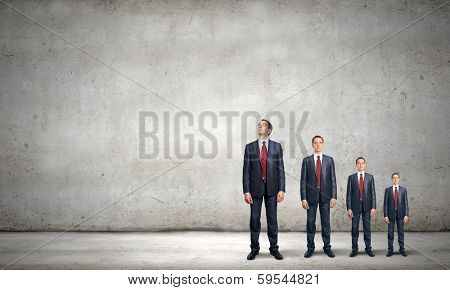 Successful confident businessmen standing in line. Progress in career poster