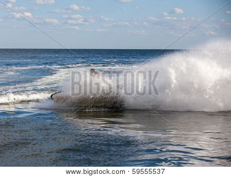 strong man drive on the jetski above the water