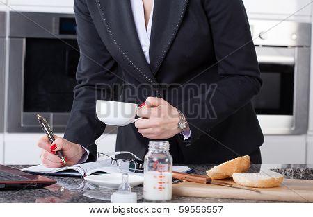 Multitasking Woman In Kitchen