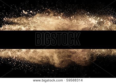 Isolated brown make-up powder in stripe shape on black background