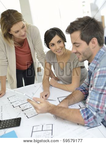 Workteam of architects meeting in office