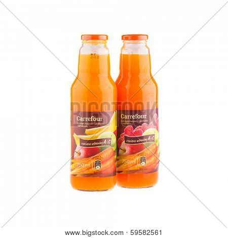 KRAKOW, POLAND - FEB 8, 2014: Juices Carrefour in assortment isolated on white. Carrefour SA, founded 1957 - French retailer, operator retail network, the second largest in the world after Wal-Mart.
