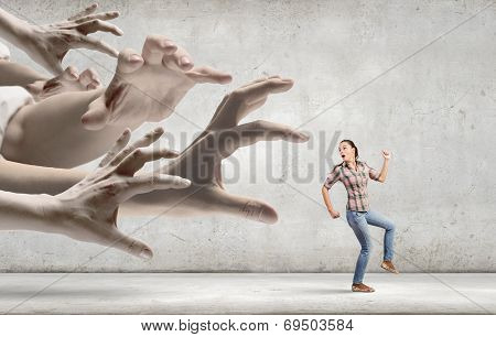 Young woman in casual escaping from big male hand