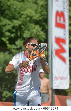 MOSCOW, RUSSIA - JULY 19, 2014: Sergey Kuptsov of Russia in the match against Italy during ITF Beach Tennis World Team Championship. Italy won 2-1