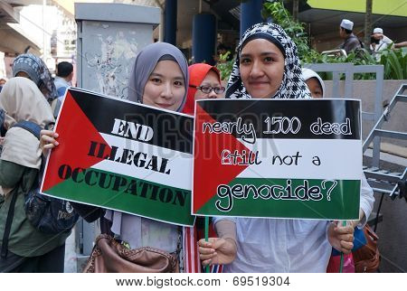 Kuala Lumpur, Malaysia - August, 2: Unidentified Malaysian hold sign protesting Israeli military strikes on Gaza, during the pro-Palestine rally in Kuala Lumpur, August 2, 2014.