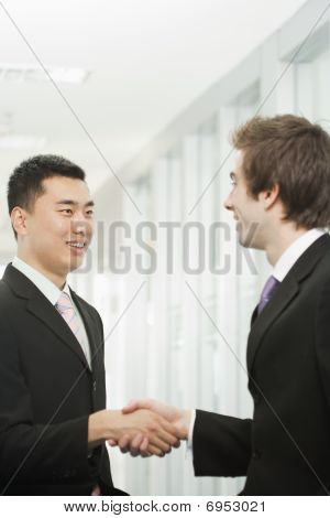Handsome Young Businessmen Greeting