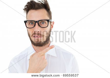 Geeky young businessman looking at camera and pointing on white background