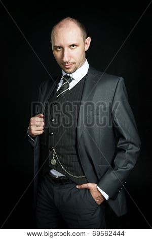 Serious bald businessman in an expensive suit
