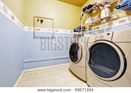 Laundry Room Interior In Light Blue And Yellow Colors