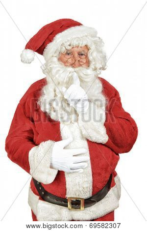Santa Claus saying shush isolated on a white background