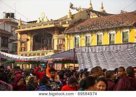 KHATMANDU, NEPAL - DEC 17, 2013: Unidentified Buddhist pilgrims near stupa Boudhanath during festive solemn Puja of H.H. Drubwang Padma Norbu Rinpoche's reincarnation's.