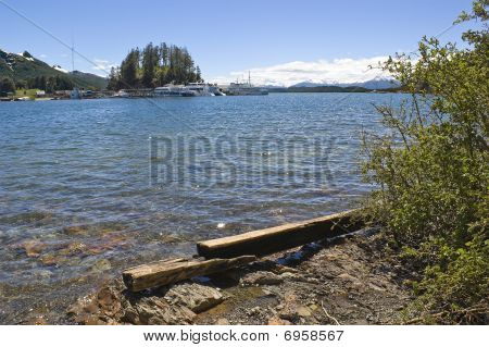 Shore And Dock In A Mountain Lake.
