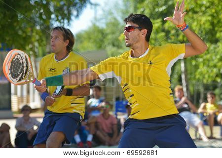 MOSCOW, RUSSIA - JULY 20, 2014: Marcus Ferreira (in front) and Vinicius Font of Brazil in the final match against Italy during ITF Beach Tennis World Team Championship. Italy won 2-0