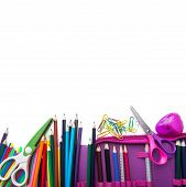School stationery in a heap bottom frame poster