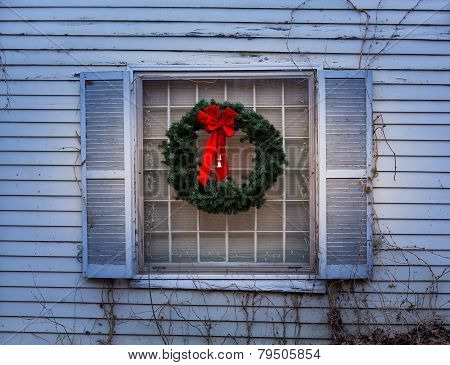 Traditional Xmas Wreath On Window