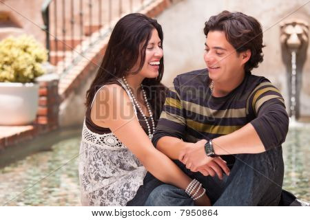 Attractive Hispanic Couple At A Fountain