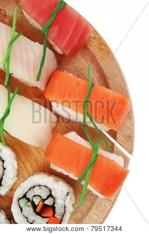 Maki Sushi and Nigiri - California Maki Roll made of fresh raw Salmon, Cream Cheese and Avocado inside with Nigiri Sushi topped with Salmon Tuna and Eel. Isolated over white background