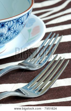 Getting ready for the meal time with utensil on the placemat