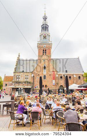 People enjoying the restaurants in the Waagplein square