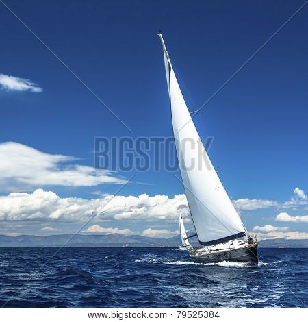 Yacht sails with beautiful cloudless sky. Sailing. Luxury yacht.