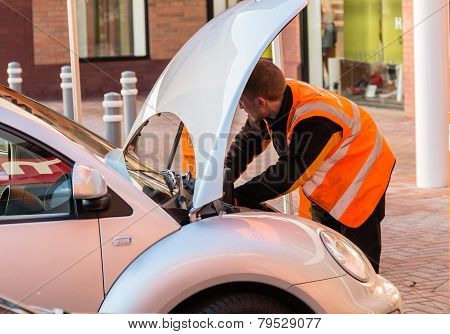 Mechanic Working On A Car Wth The Bonnet (hood) Up