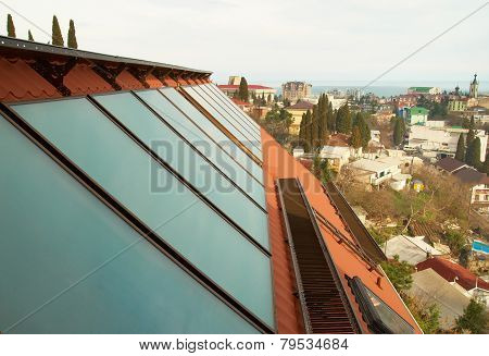 Solar water heating system (geliosystem) on the red house roof. poster