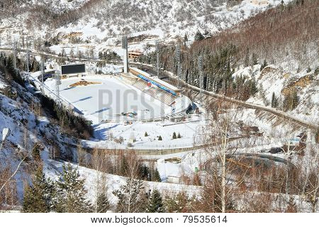 The Medeo (or Medeu) is an outdoor speed skating and bandy rink located in a mountain valley on the south-eastern outskirts of Almaty Kazakhstan. Captured during winter poster