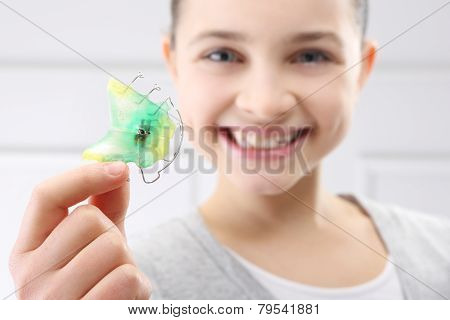 Child with orthodontic appliance