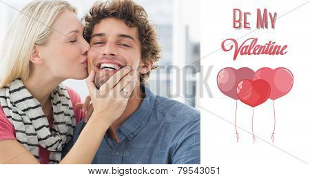Woman kissing man on his cheek against cute valentines message poster