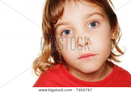 portrait small child in a red t-shirt photography studio