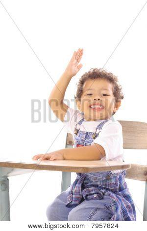 happy toddler at desk