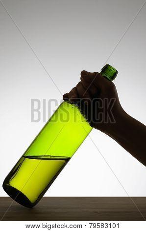 Female Hand Grabbing A Bottle