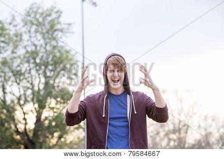 Young Man In Hoodie Screaming
