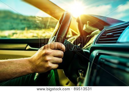 Summer Time Car Trip. Car Traveling. Men Driving Down the Road During Scenic Sunset. poster