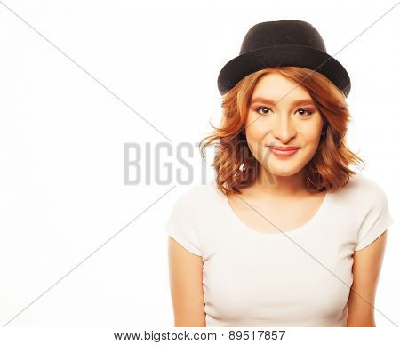 life style, happiness, emotional and people concept: Beautiful young  woman wearing white shirt and black hat looking at camera and make different emotions while standing against white background