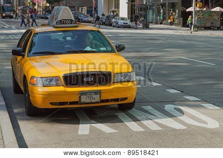 Taxi Is Standing At The Curb