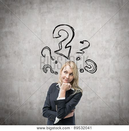 Beautiful Business Woman Is Thinking About Client Services Solutions. Drawn Question Marks On The Co