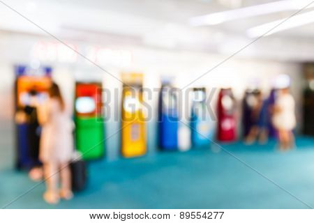 Blurry People With Automatic Teller Machine