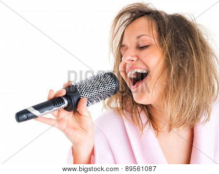 Woman singing with hairbrush isolated on white background poster