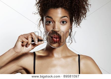 Prety Black Woman Sending Kiss In Magnifying Glass