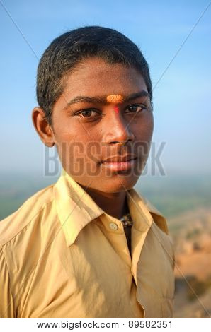 KAMALAPURAM, INDIA - 03 FEBRUARY: Young Indian pilgrim with bindi on hilltop
