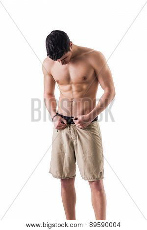 Handsome athletic shirtless young man isolated