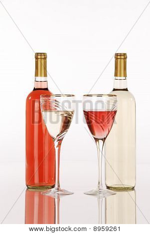 White And White Zinfandel Wine Bottles And Glasses
